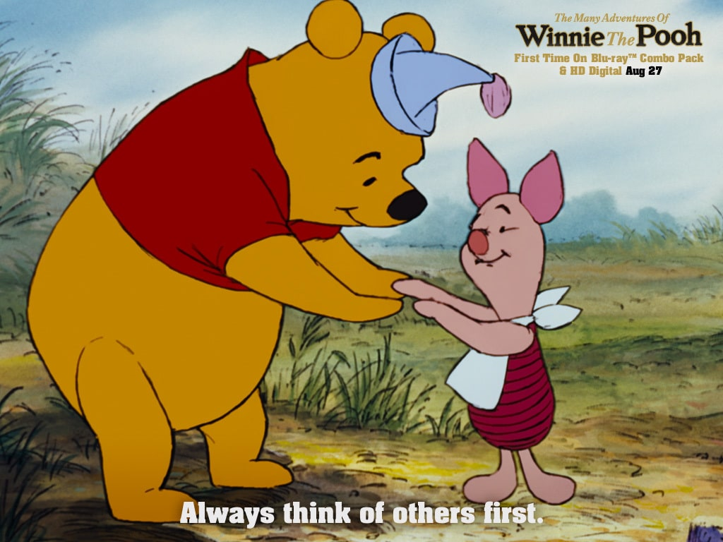 Pooh (voiced by Sterling Holloway) holding hands with Piglet (voiced by John Fiedler) in the movie The Many Adventures Of Winnie The Pooh