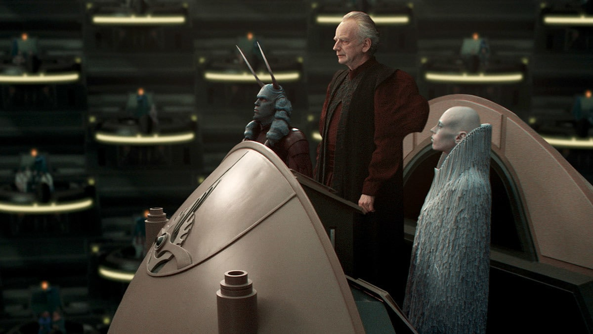 Palpatine and his entourage addressing the Galactic Senate
