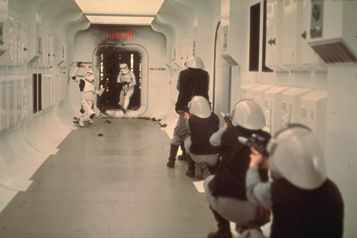 Rebel soldiers attempting to defend the Tantive IV against boarding Stormtroopers