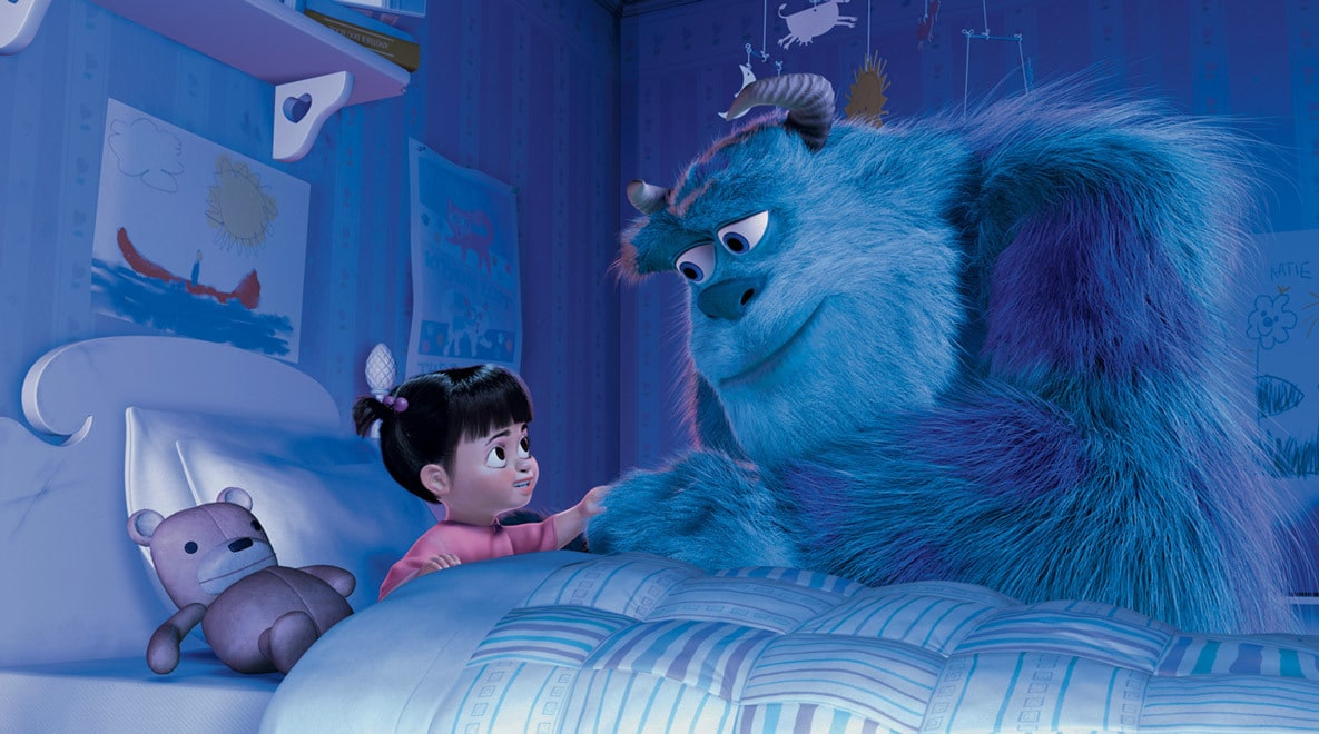John Goodman as Sully holding hands with Boo who tucked into her bed next to her teddy bear in Monsters, Inc.