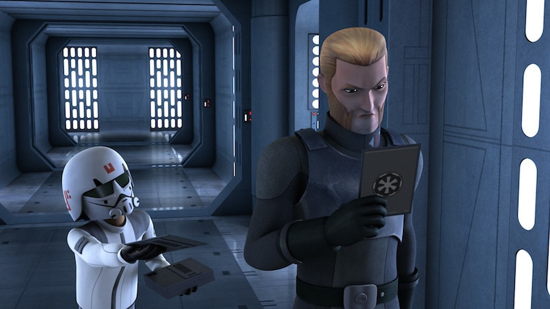 Agent Kallus inspecting a datapad from a disguised Ezra Bridger
