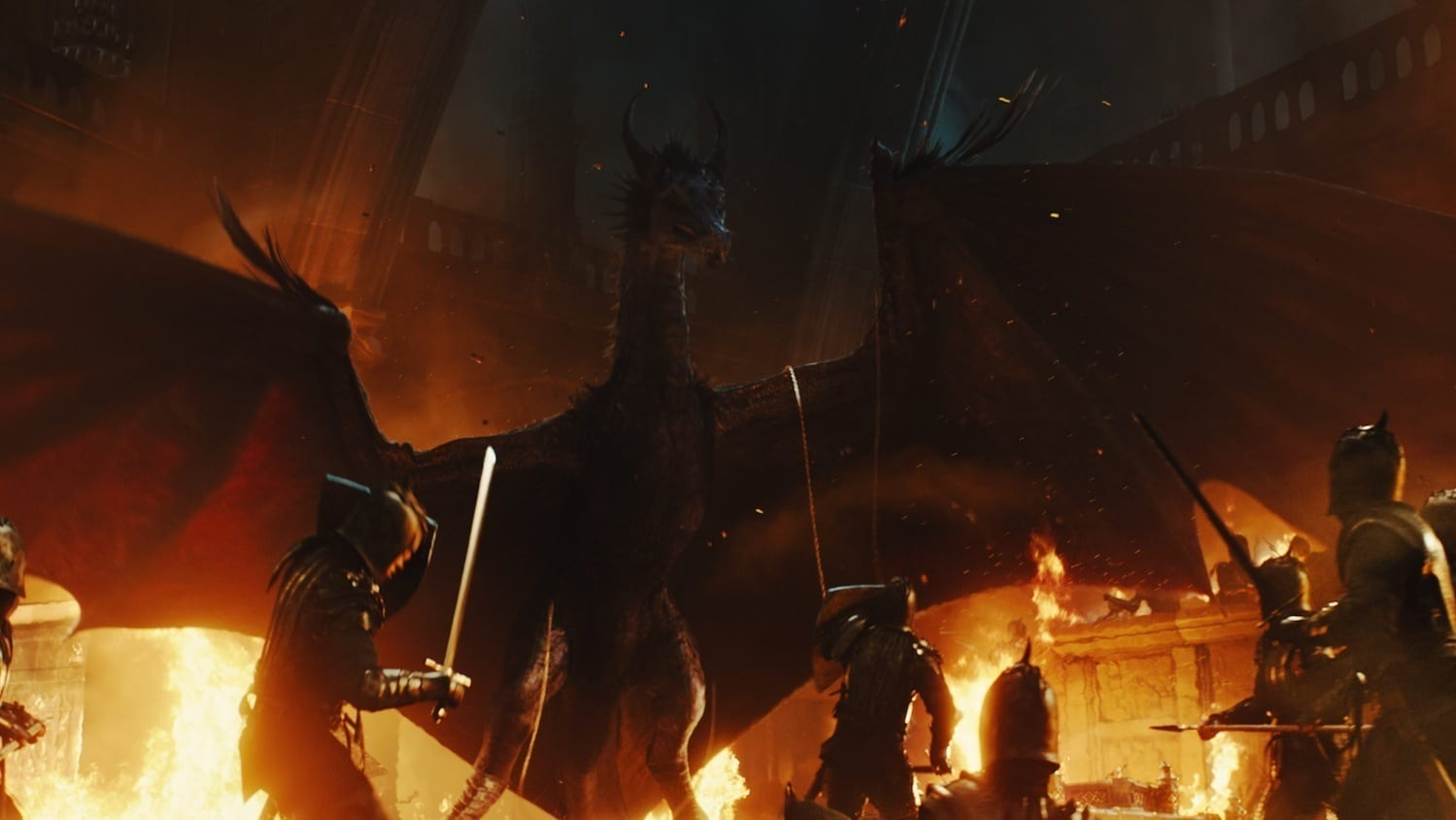 """Maleficent as a dragon, surrounded by soldiers and fire, in the movie """"Maleficent"""""""