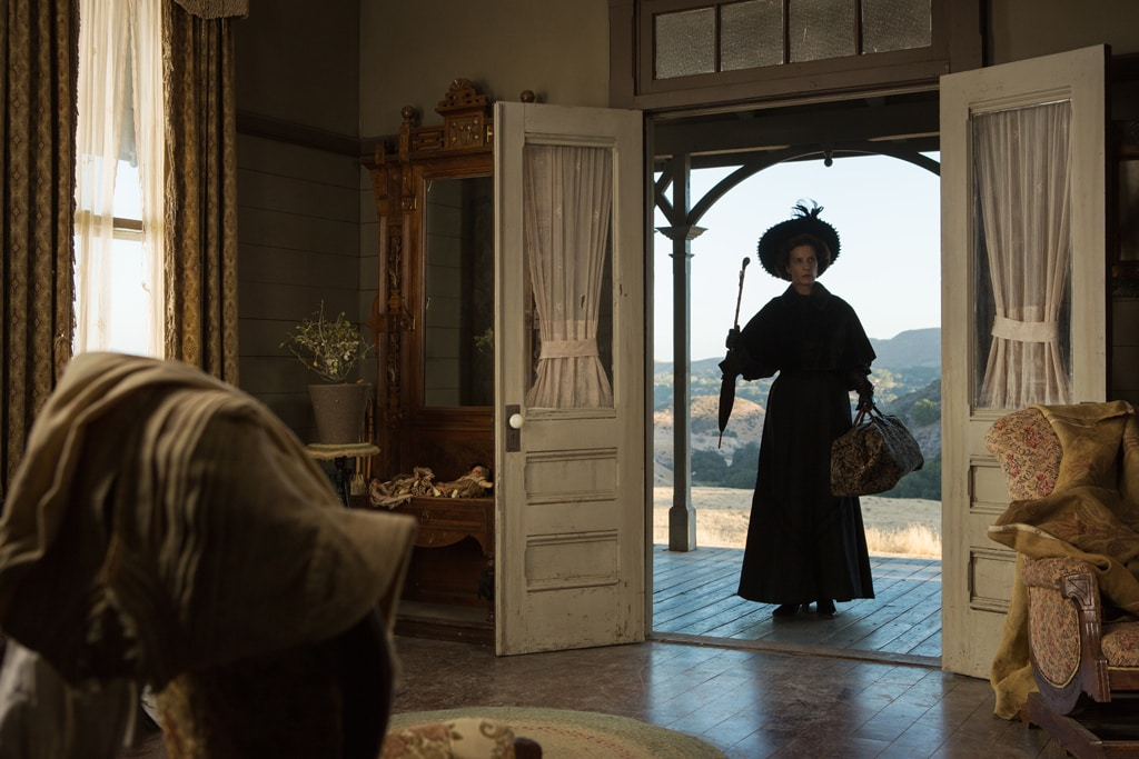 """Actor Rachel Griffiths as Aunt Ellie entering a house in """"Saving Mr. Banks""""."""