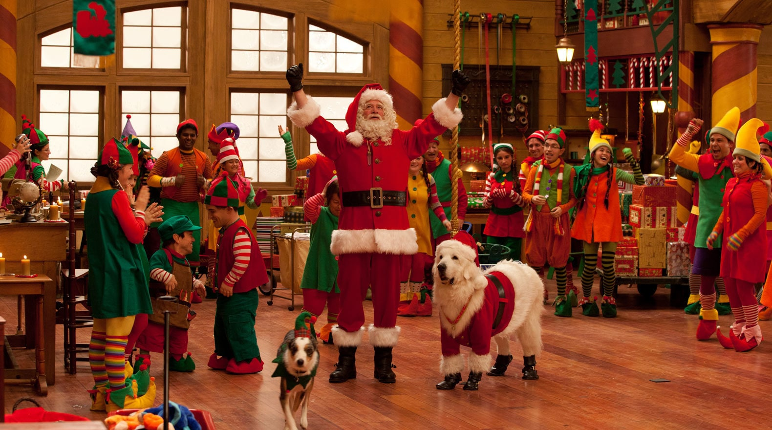 Santa and his Dog in the middle of Santa's workshop