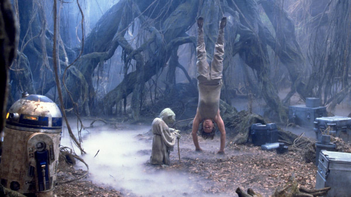 Luke Skywalker training with Yoda on Dagobah