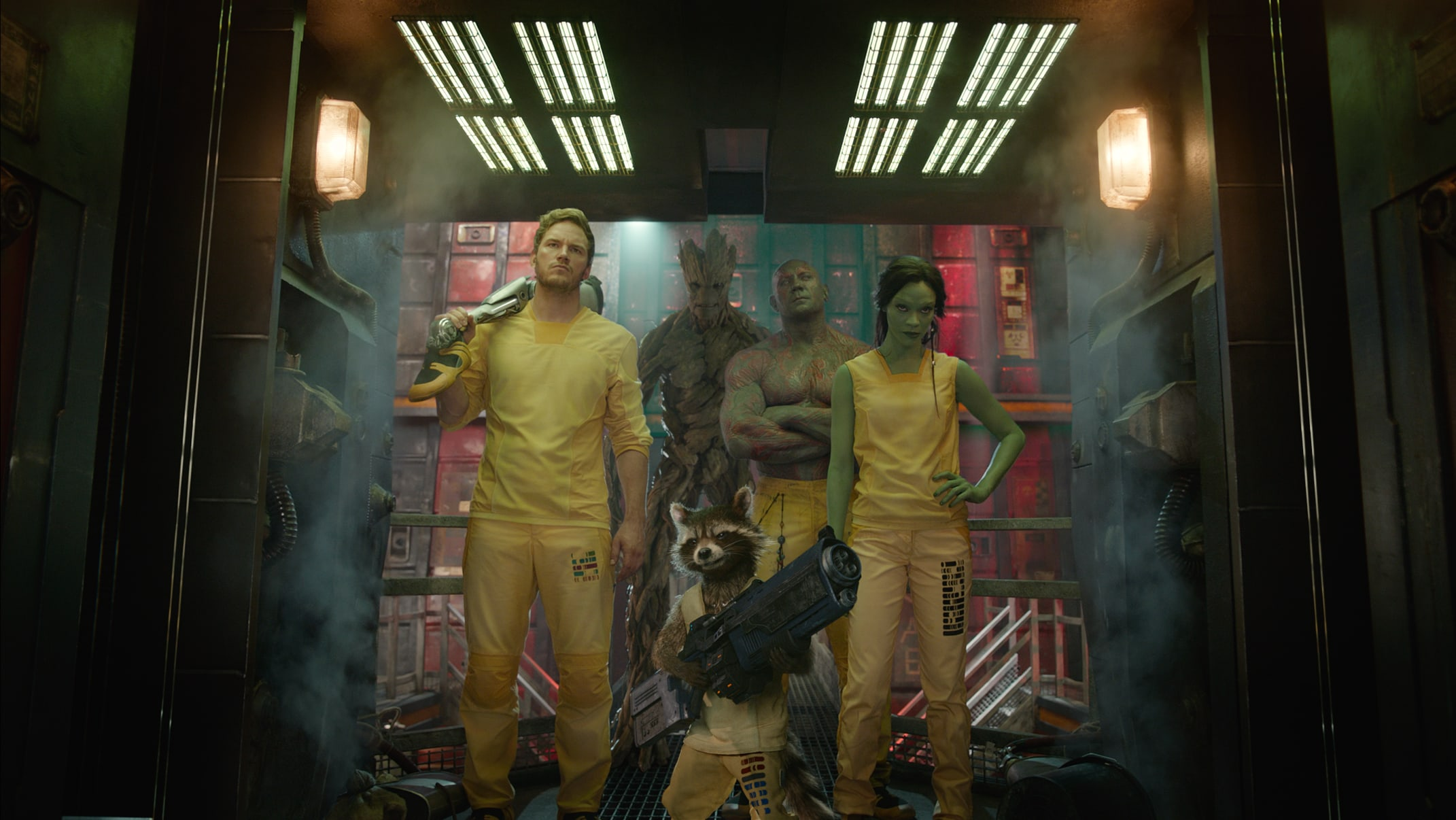 Star Lord, Groot, Rocket, Drax, and Gamora in yellow prisoner outfits in the movie Guardians of the Galaxy