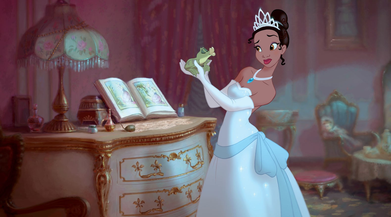 Naveen as a frog held by Tiana in The Princess and the Frog