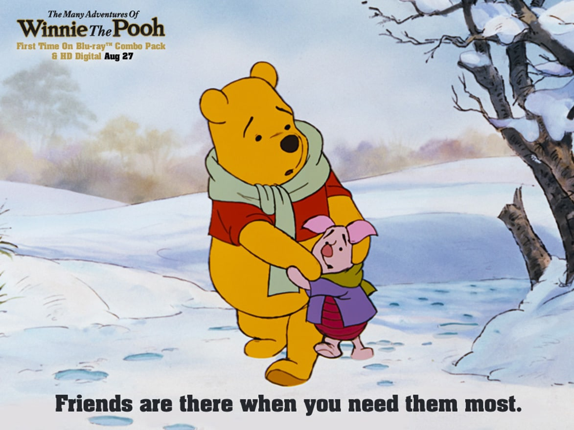 Pooh (voiced by Sterling Holloway) walking with Piglet (voiced by John Fiedler) in the snow in the movie The Many Adventures of Winnie The Pooh