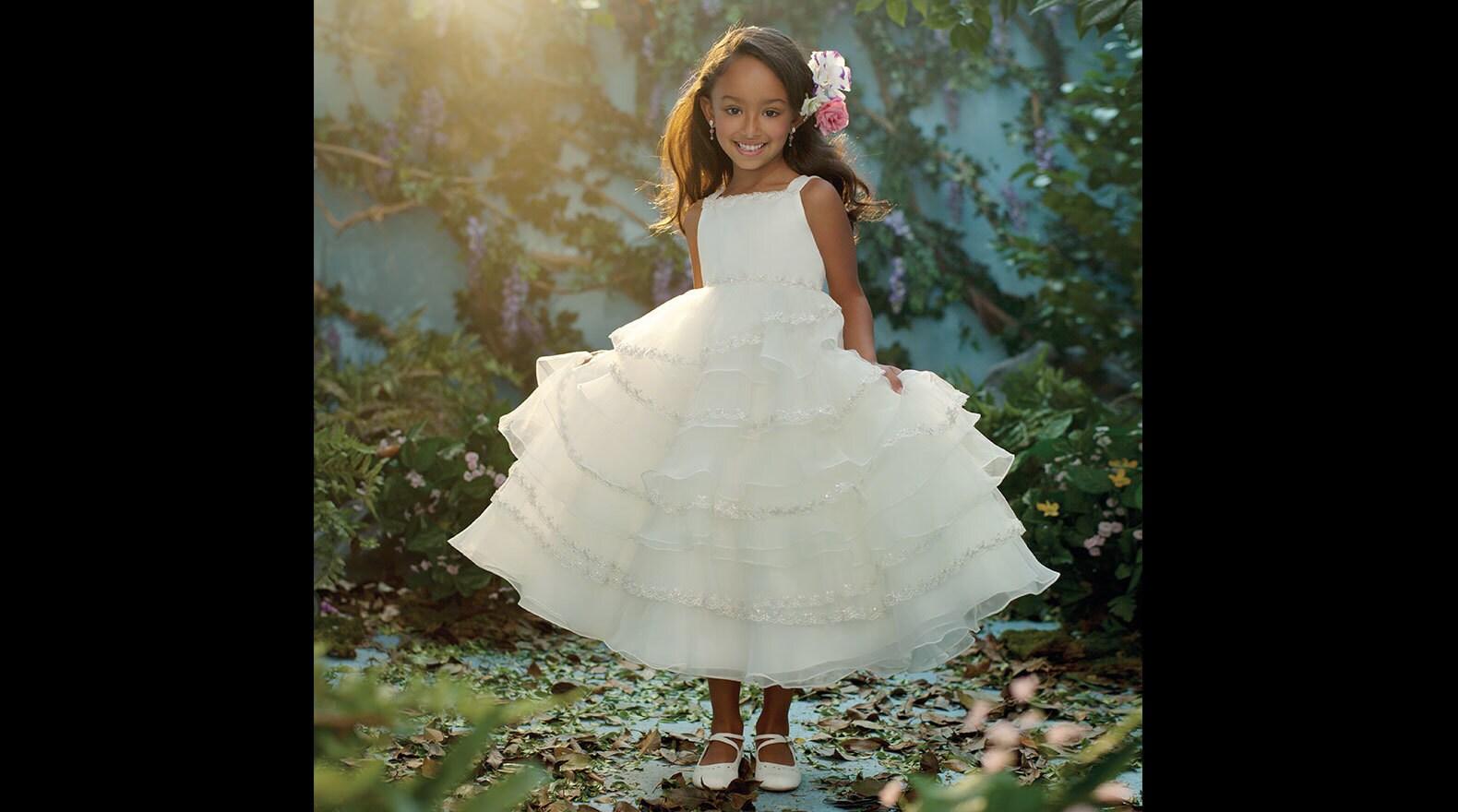 Girl wearing a Tiana inspired princess dress