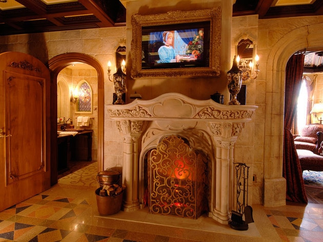 Centerpiece of the Cinderella Castle Suite is an antique limestone fireplace – 17th century Gothi...