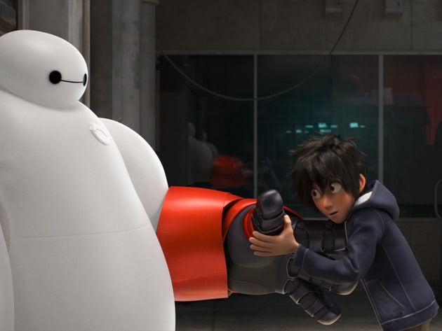 """Hiro (voiced by Ryan Potter) holding armored hand of Baymax (voiced by Scott Adsit) in the movie """"Big Hero 6"""""""