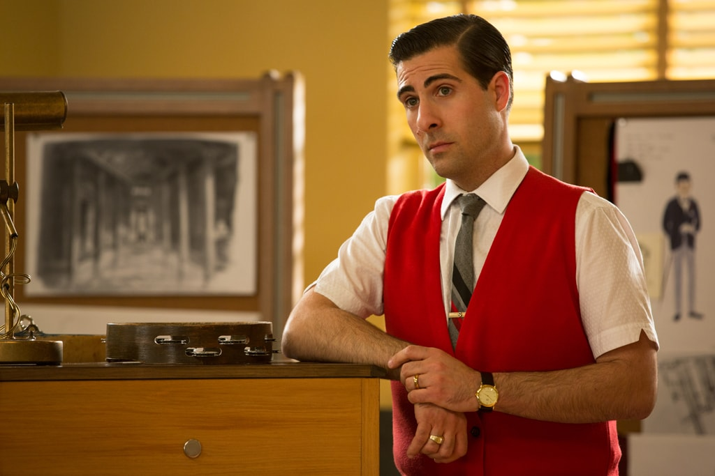 """Actor Jason Schwartzman as Richard Sherman leaning against a piano in the movie """"Saving Mr. Banks""""."""