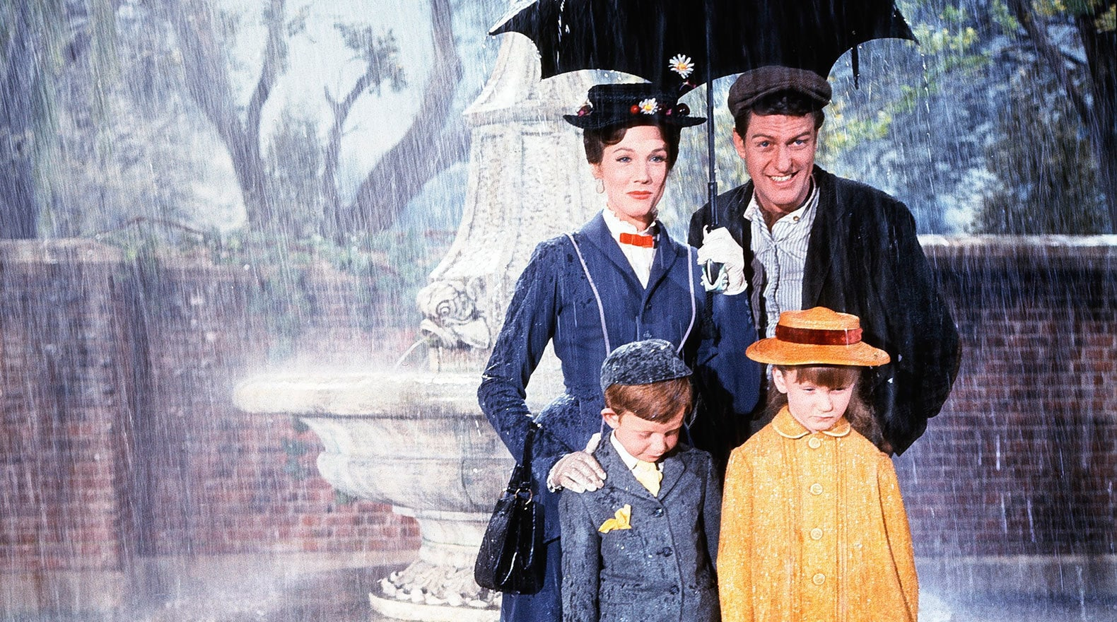 """Mary, Bert, Jane, and Michael are caught in a typical London shower in """"Mary Poppins"""""""