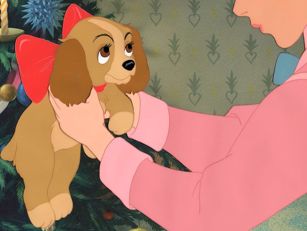 Darling unwraps her Christmas present and discovers it's a puppy.
