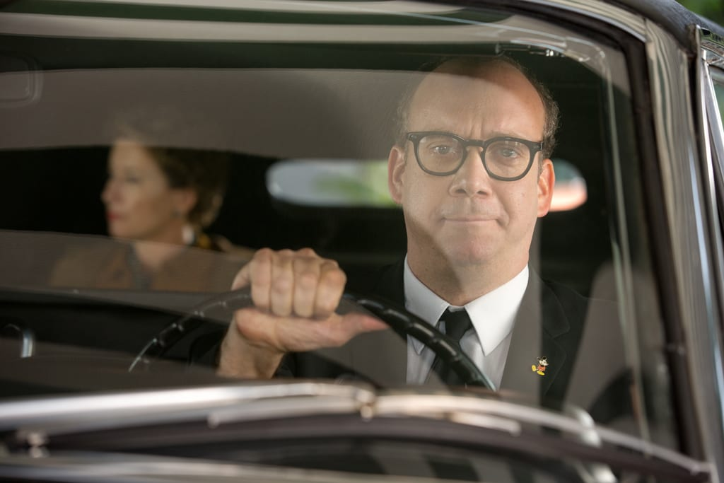 """Actor Paul Giamatti (as Ralph) driving a car with actor Emma Thompson (as P.L. Travers) in the back seat in the movie """"Saving Mr. Banks""""."""