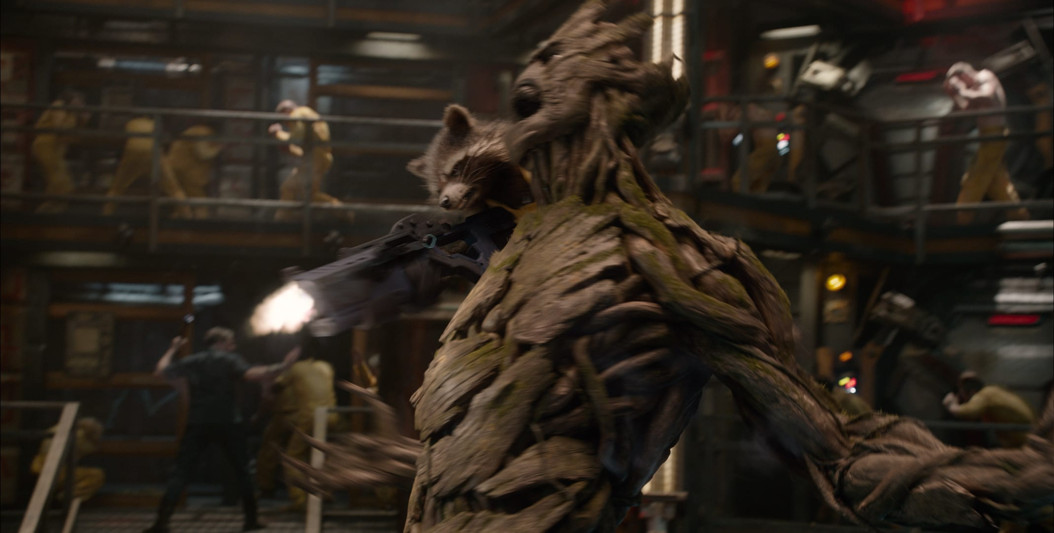 Rocket riding on Groots shoulder while shooting enemies in the movie Guardians of the Galaxy