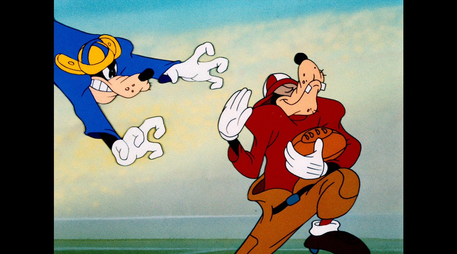 Goofy teaches everyone a thing or two about how to play football.