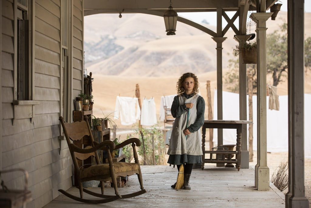 """Actor Annie Rose Buckley as Ginty on a porch in the movie """"Saving Mr. Banks""""."""