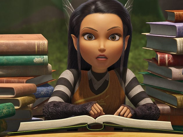 Nyx pours over her collection of books.