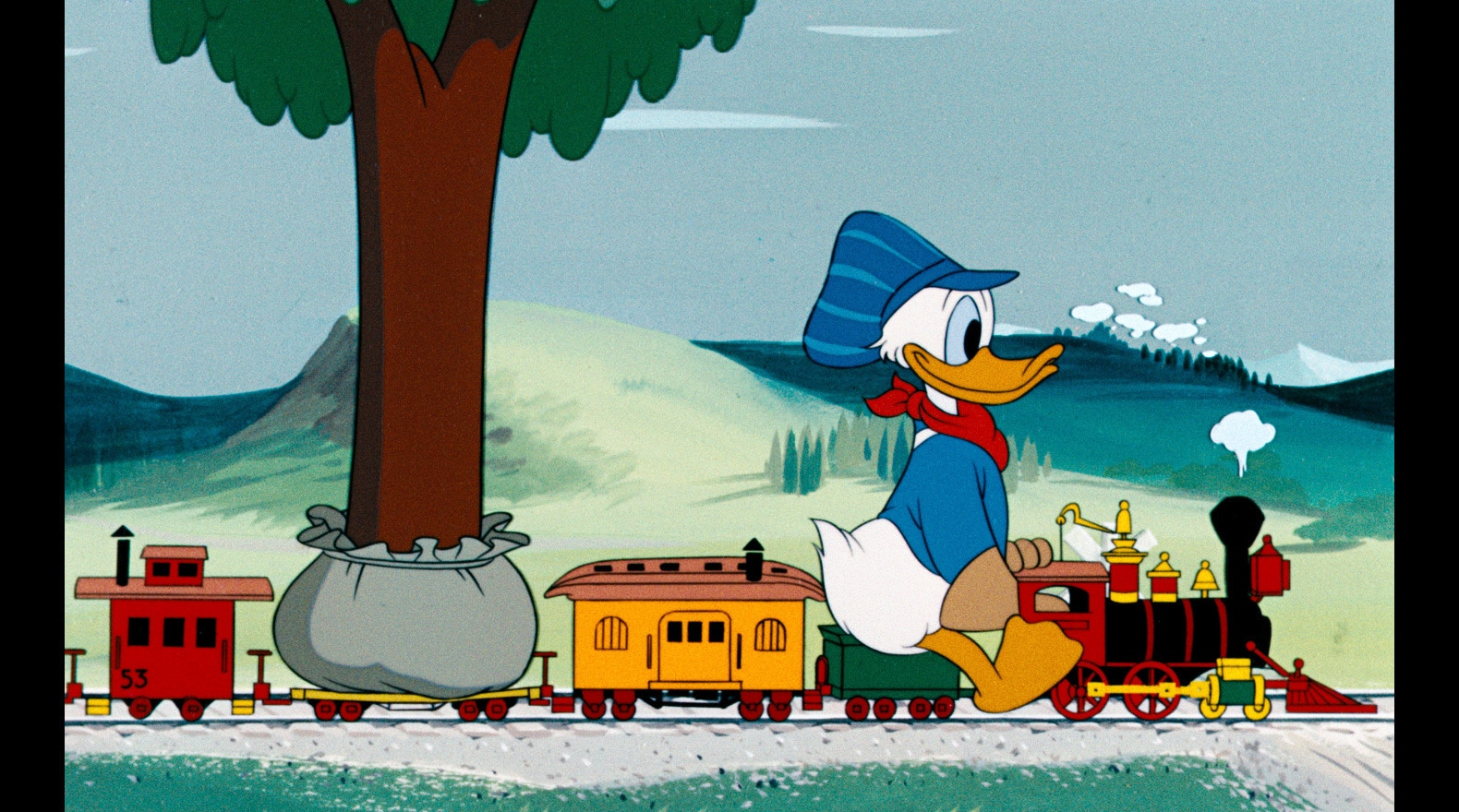 Donald enjoys a little time with his model train set.