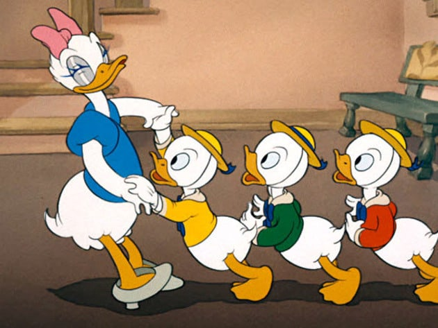 Daisy does a little dancing with Huey, Dewey, and Louie.