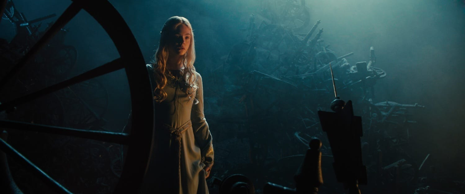 """Elle Fanning as Aurora staring at the spindle in the movie """"Maleficent"""""""