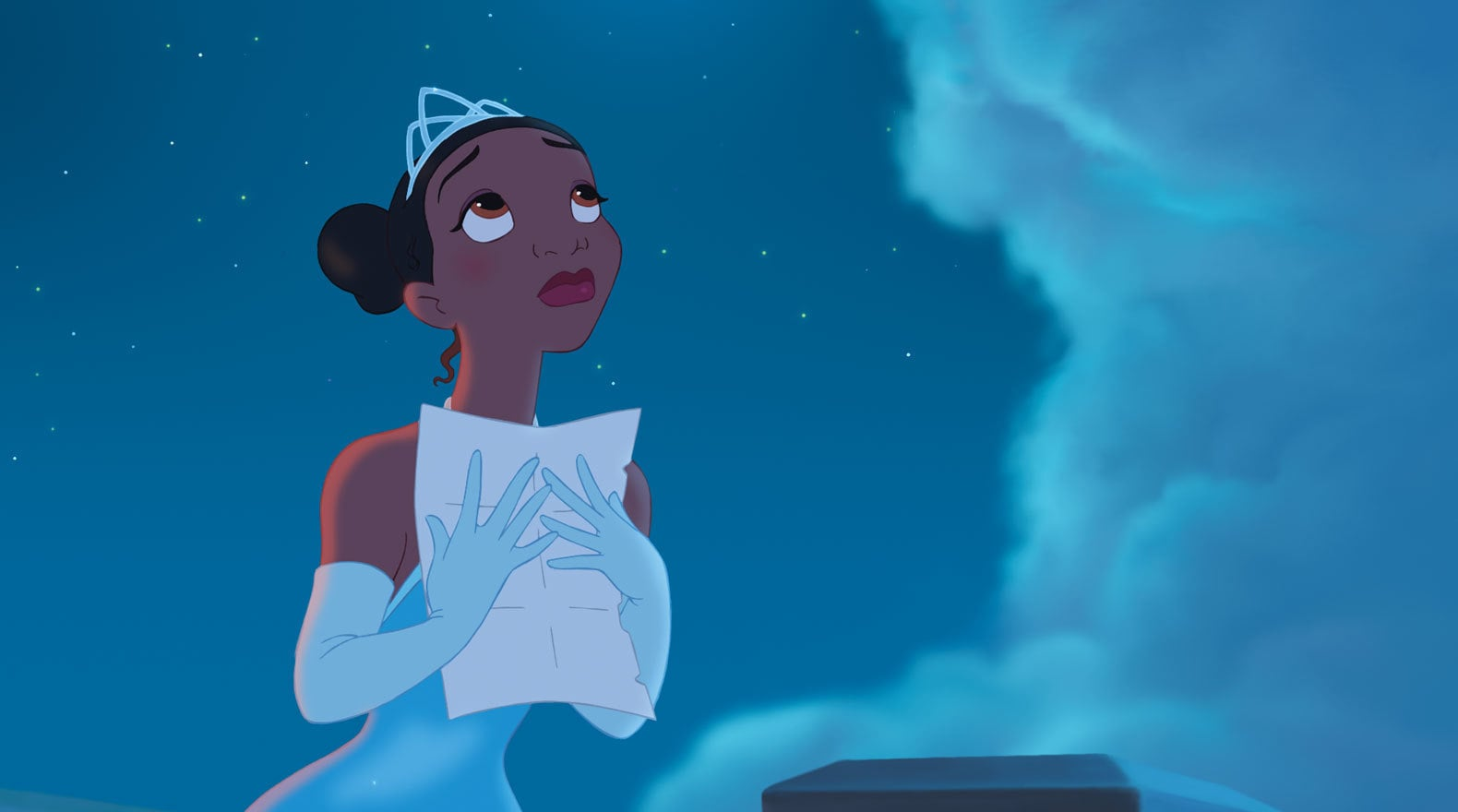 Tiana clutches a letter to her chest
