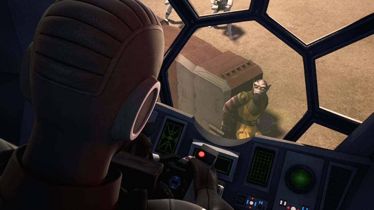 Zeb Orrelios looking into the cockpit of a TIE Fighter