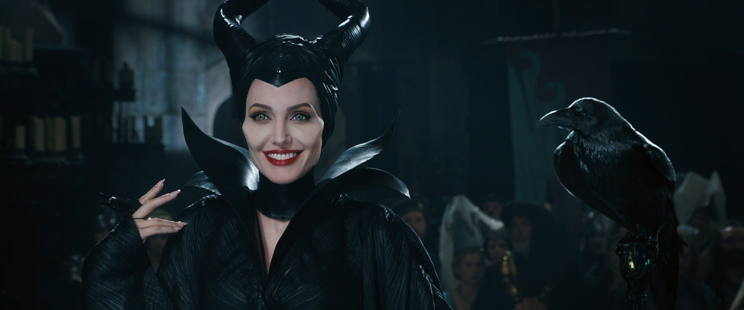 """Angelina Jolie as Maleficent smiling with her pet Raven, Diablo in the movie """"Maleficent"""""""