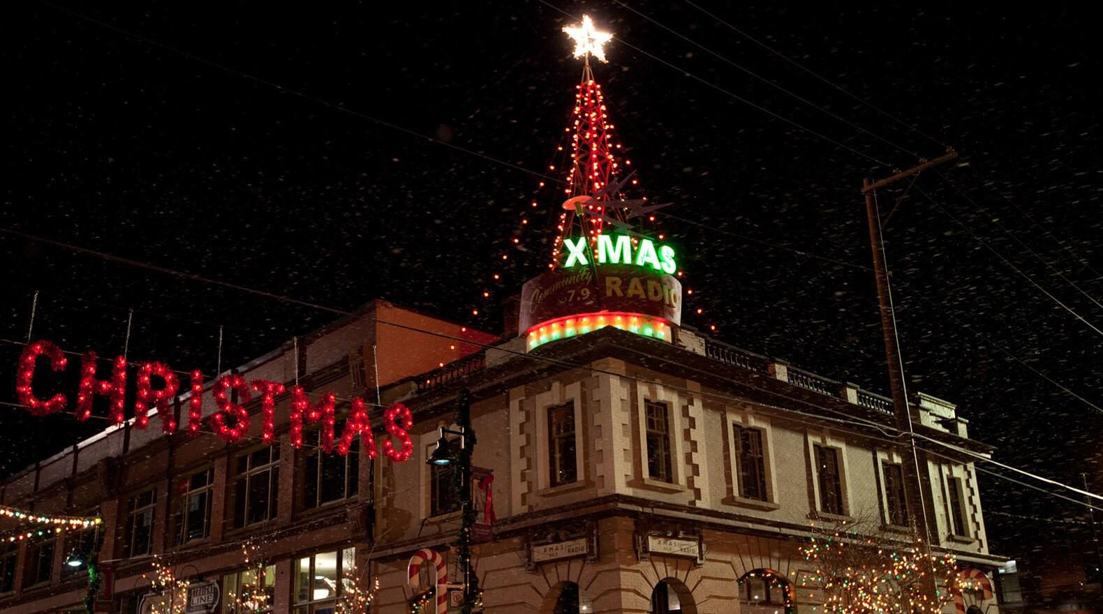 Christmas lights atop  a radio station