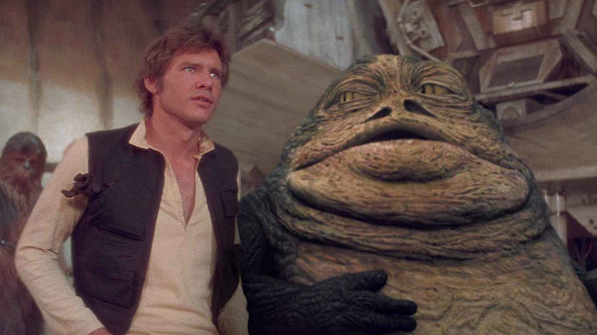 Jabba the Hutt and Han Solo discussing Han's debt