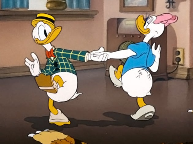Donald and Daisy cutting a rug in the living room.
