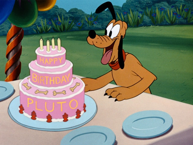 Pluto celebrates his birthday with three tiers of fun.