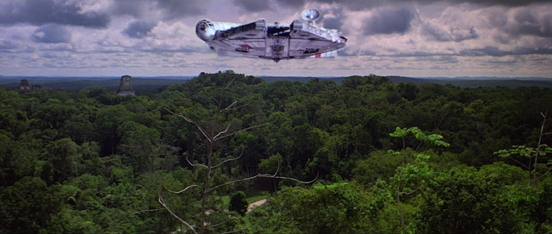The Millennium Falcon flying over Yavin IV
