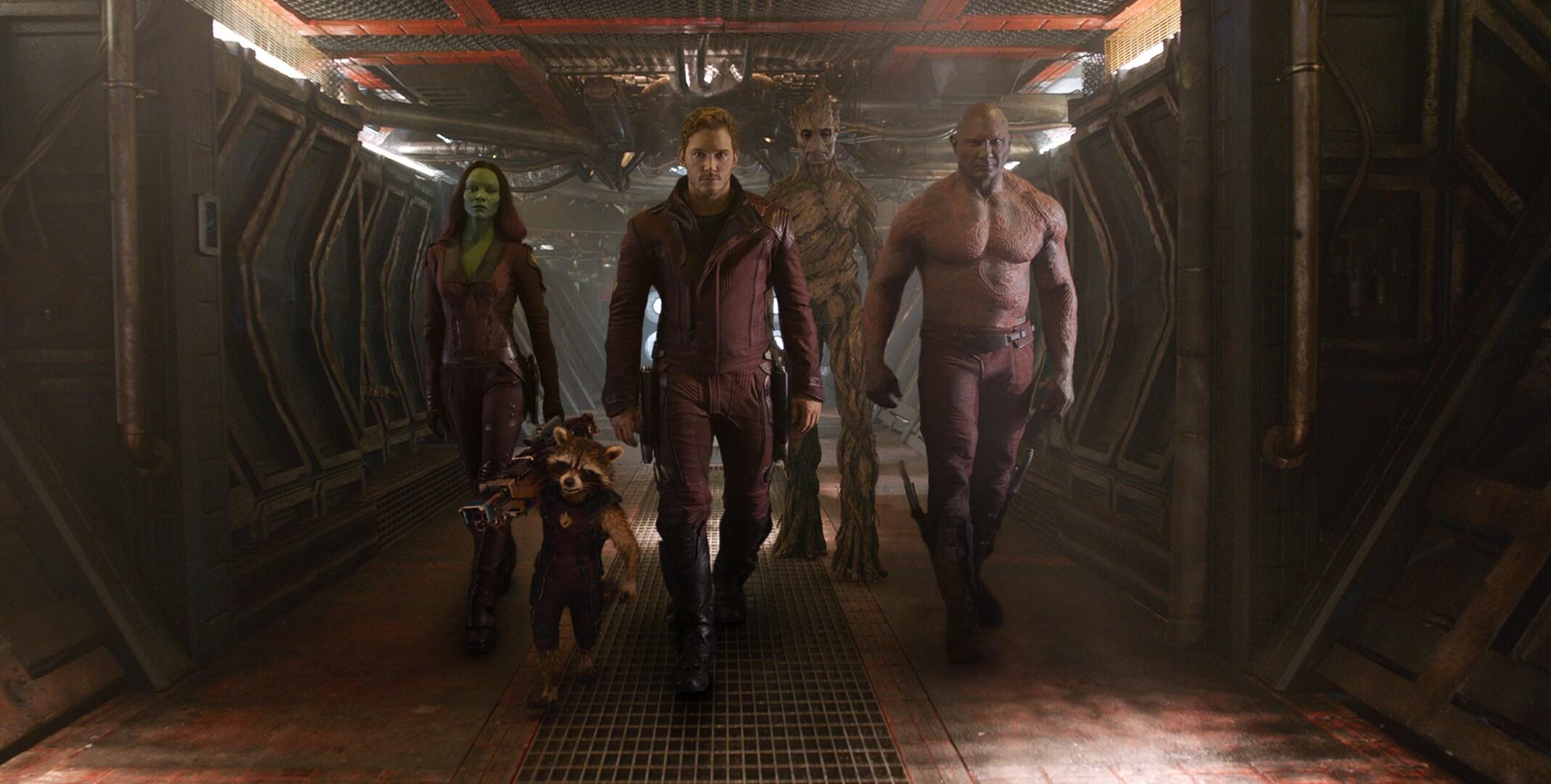 Zoë Saldaña as Gamora, Chris Pratt as Quill, Bradley Cooper as Rocket (Raccoon), Dave Bautista as Drax, and Vin Diesel as Groot imprisoned