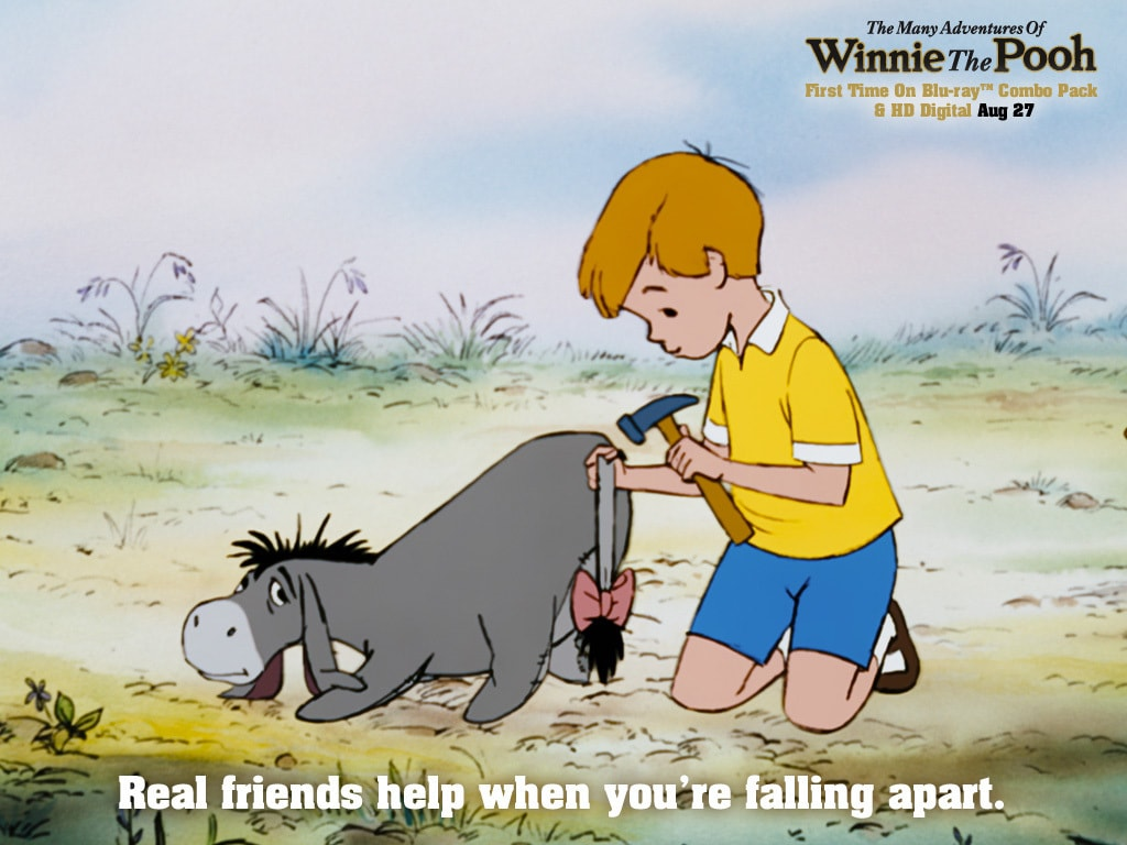 Christopher Robin (voiced by John Walmsley) pinning the tail back on Eeyore (voiced by Ralph Wright) in the movie The Many Adventures Of Winnie The Pooh