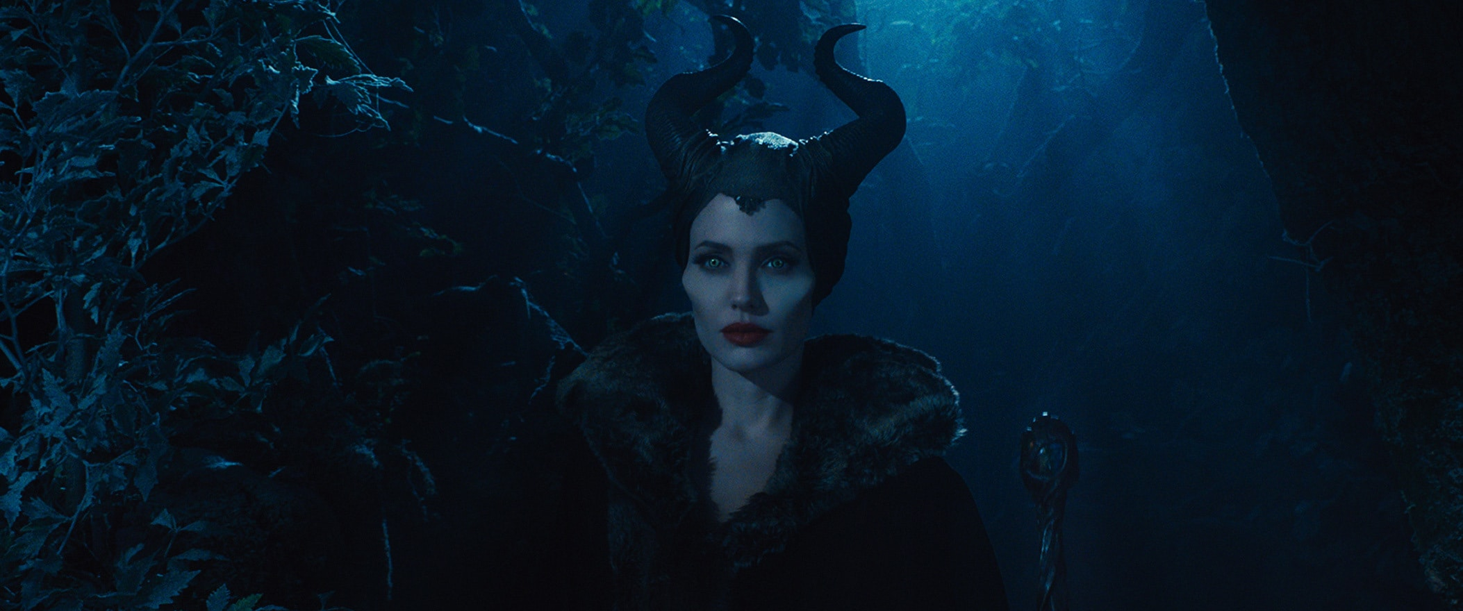 Angelina Jolie as Maleficent in the forest