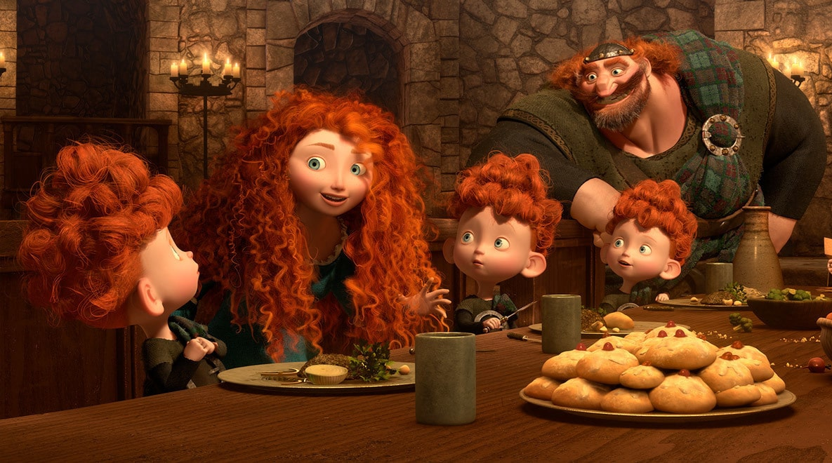 Merida (voiced by Kelly Macdonald) her triplet bothers, and Fergus (voiced by Billy Connolly) at the dinner table talking in the movie Brave