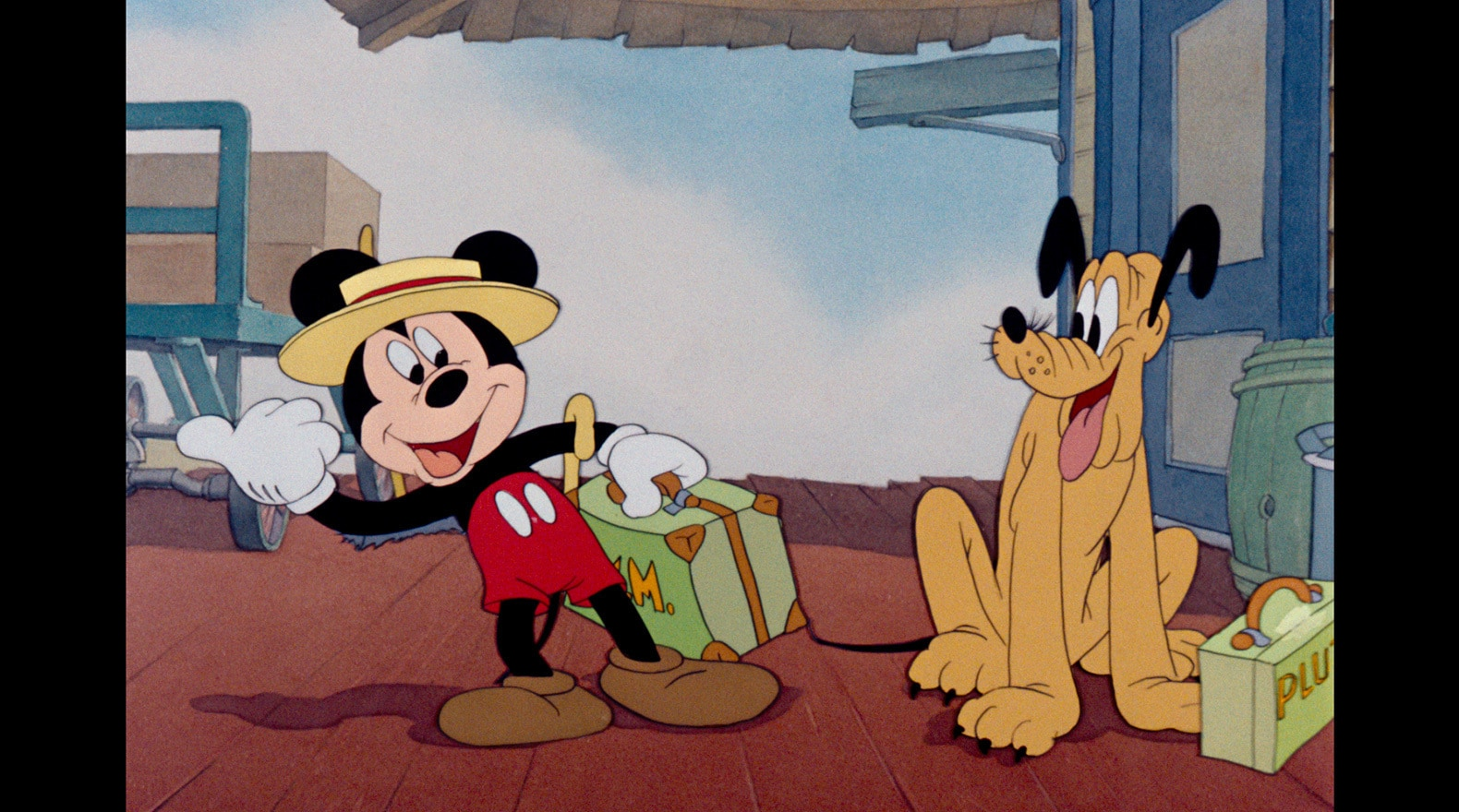 Mickey gets ready for a trip on the train, with Pluto in tow.