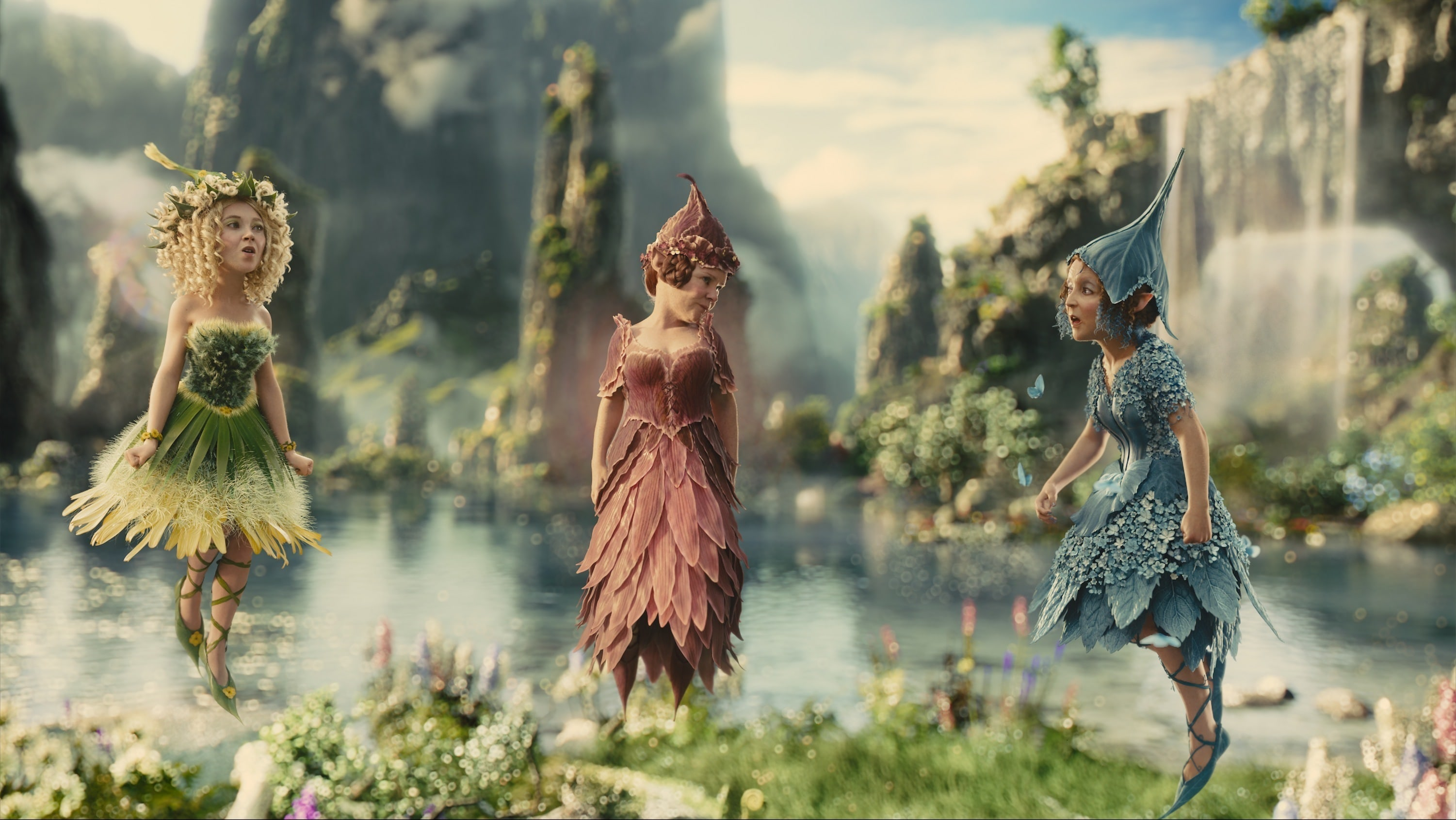 """The three flower pixies, Knotgrass (played by Imelda Stauton), Flittle (played by Lesley Manville), and Thistlewhit (played by Juno Temple) in the movie """"Maleficent"""""""