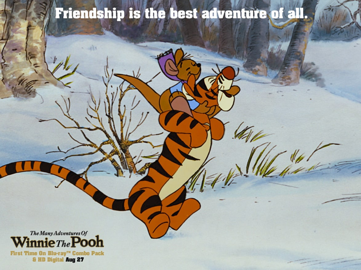 Tigger (voiced by Paul Winchell) hopping with Roo (voiced by Dori Whitaker) on his back in the movie The Many Adventures Of Winnie The Pooh
