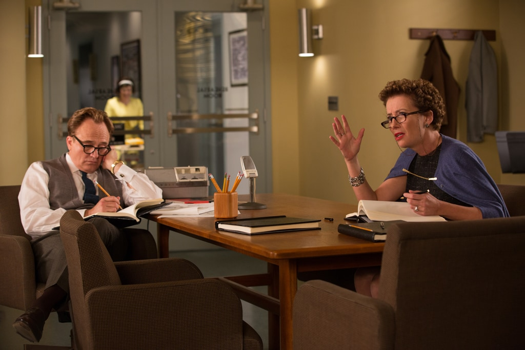 """Actors Bradley Whitford (as Don DaGradi) and Emma Thompson (as P.L. Travers) sitting at a desk talking and writing in the movie """"Saving Mr. Banks""""."""