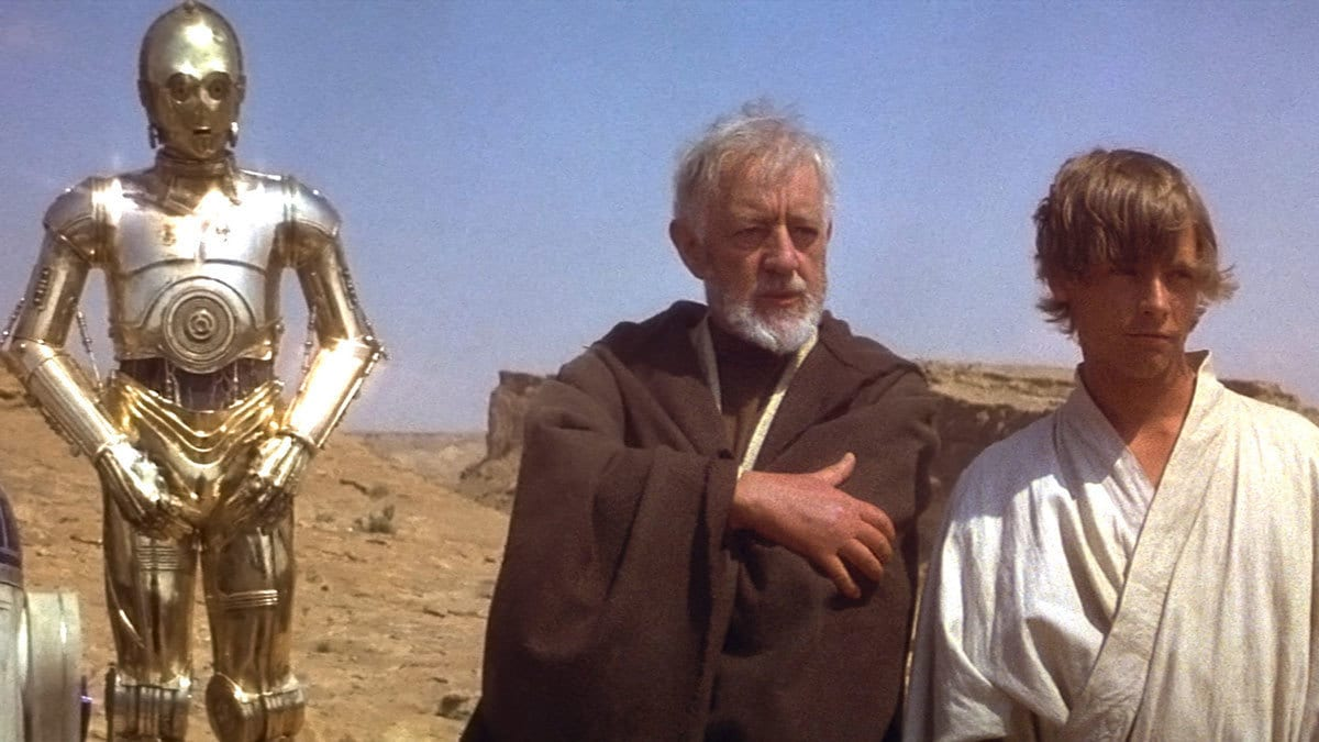 Obi-Wan Kenobi, Luke Skywalker, C-3PO, and R2-D2 overlooking Mos Eisley