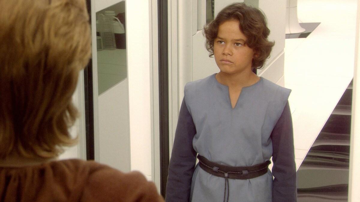 A young Boba Fett greeting Obi-Wan Kenobi