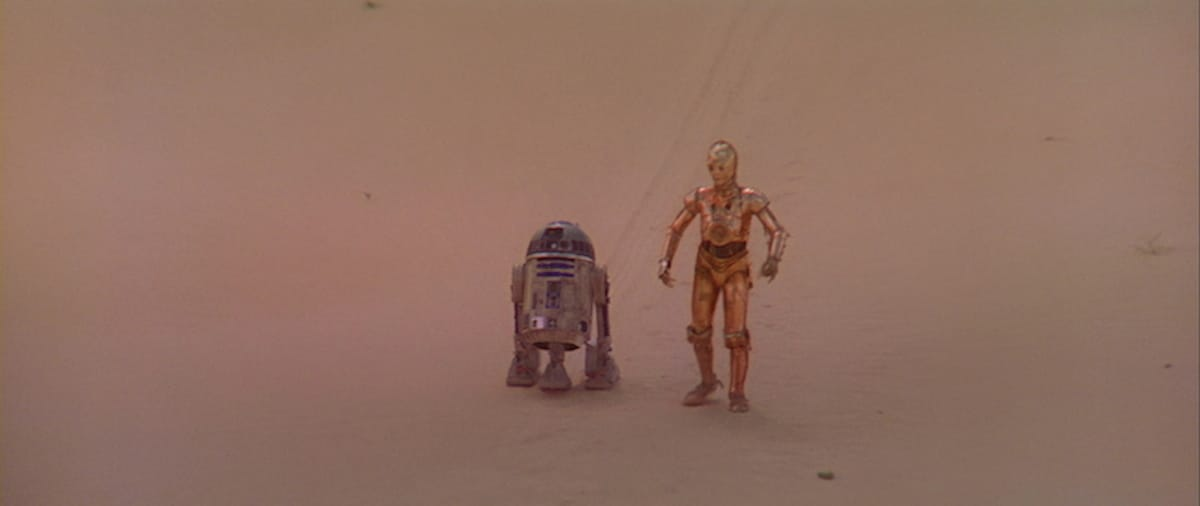 R2-D2 and C-3PO traversing the Jundland Wastes