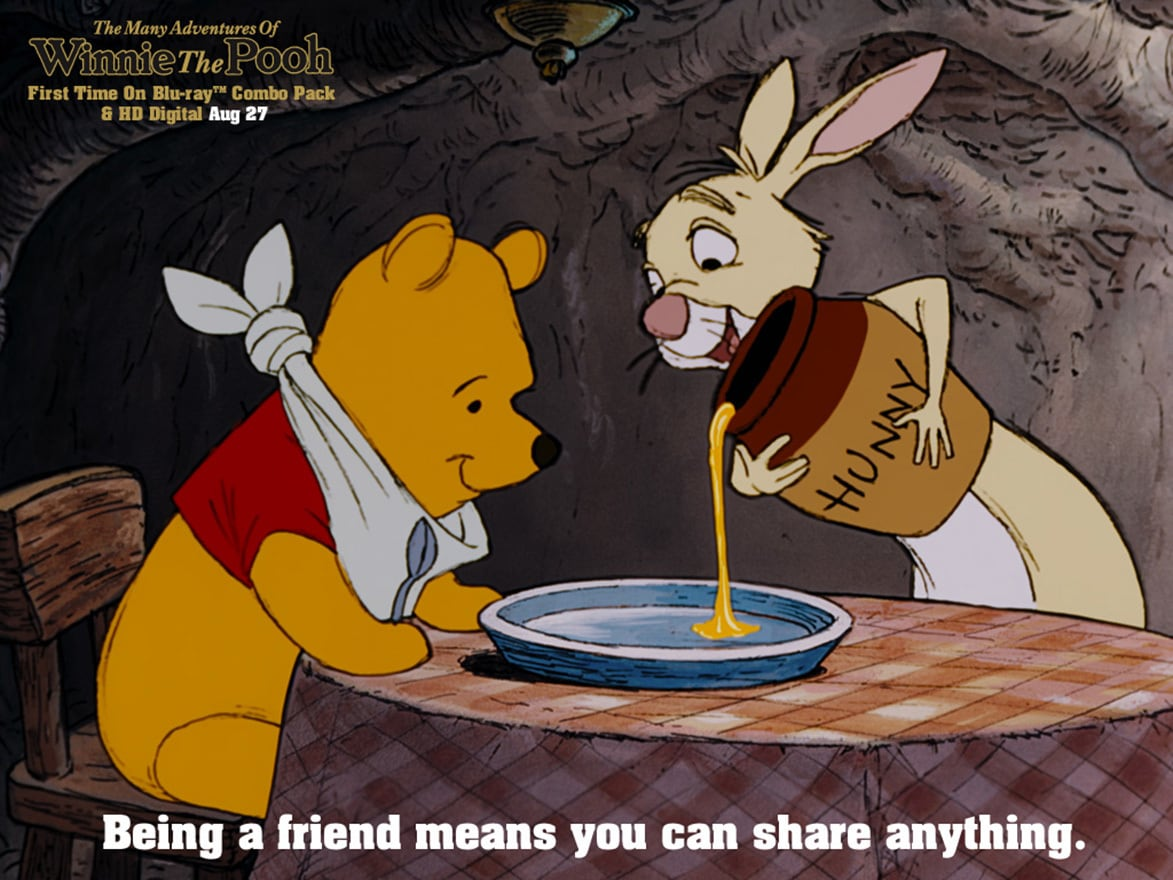 Rabbit (voiced by Junius Matthews) pouring honey for Pooh (voiced by Sterling Holloway) in the movie The Many Adventures Of Winnie The Pooh