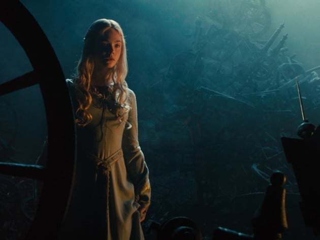 Aurora comes to face to face with the famous spindle in this image from Maleficent.