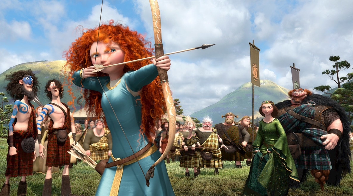Merida, voiced by Kelly Macdonald, aiming her bow and arrow in the movie Brave. Her mother Elinor, voiced by Emma Thompson, and father Fergus, voiced by Billy Connolly are in the background.