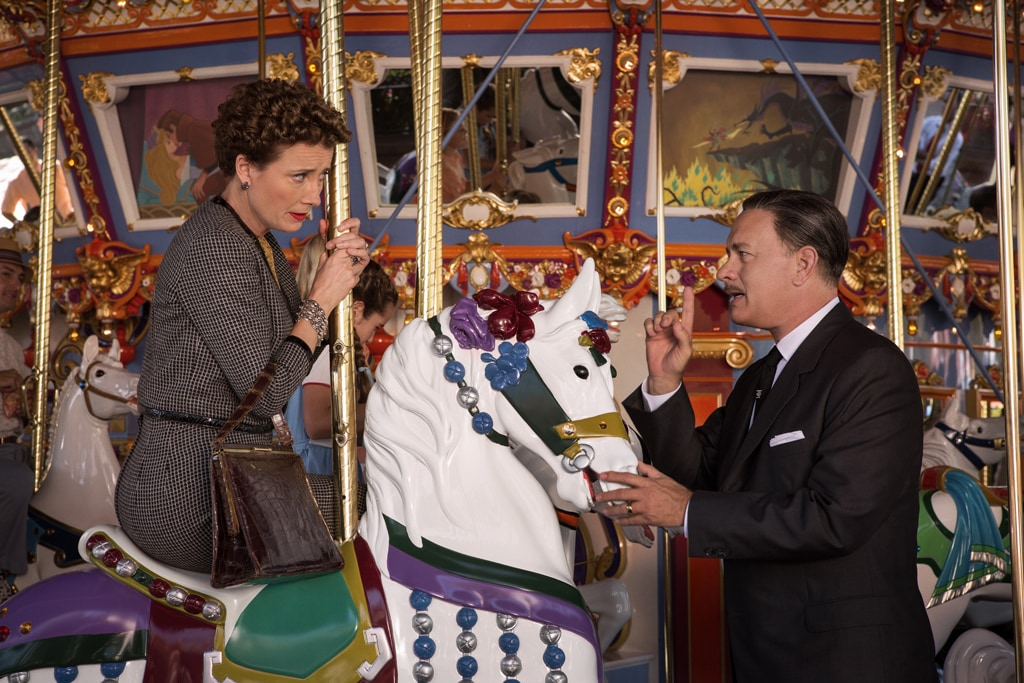"""Actors Tom Hanks (as Walt Disney) and Emma Thompson (as P.L. Travers) riding a carousel in the movie """"Saving Mr. Banks""""."""