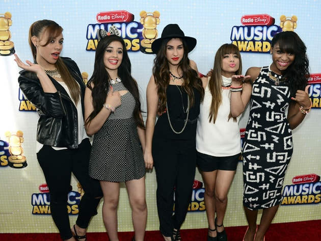 "Fifth Harmony - ""The ""N.B.T."" featured artists posing on the RDMA 2013 red carpet."